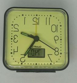 2 PC glow-in-the-dark alarm clock.  time and temperature.