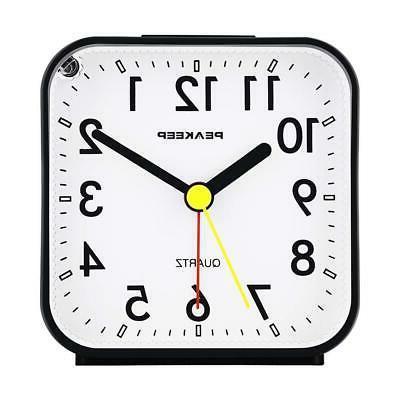battery analog alarm clock ticking