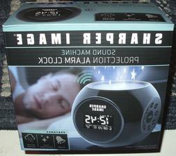 Sharper Image Sound Machine & Star Projection Alarm Clock. N